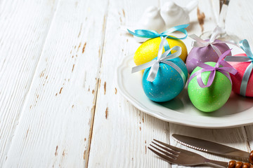 Spring Easter Table setting on white wooden table