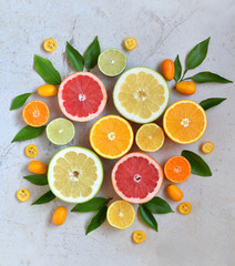 Set of citrus on light background: orange, mandarin, lemon, grapefruit, lime, kumquat, tangerine. Fresh organic juicy fruits. Source of vitamin C. Healthy food concept. Copy space
