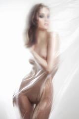 nude woman. sexy girl behind a polyethylene