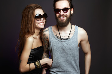 happy smiling beautiful couple in sunglasses
