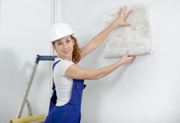 young woman with  roll of wallpaper