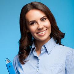 Young businesswoman with folder, on blue