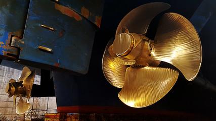 black ship hull and golden propeller at drydock Wall mural