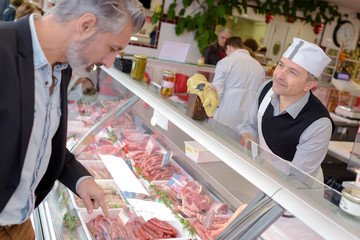 Man choosing from meat counter