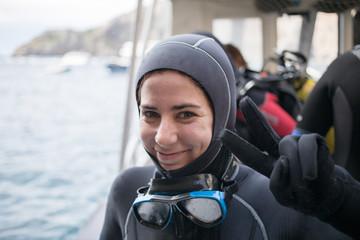 Cheerful woman preparing for diving