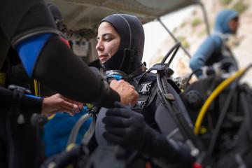 Woman diver preparing to dip