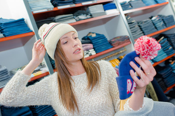 Woman shopping for a hat