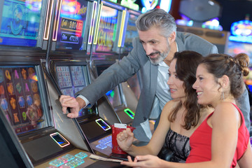 group of people playing at a slot in a casino