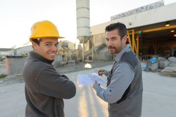 view of two workers working outside on a construction site