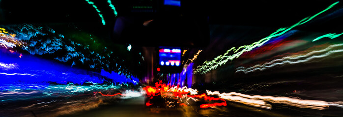 Colorful Abstract Defocused motion blurred speed light trails inside Car in Night scene Fotomurales