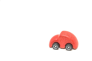 Isolated Red wooden car toy on white background