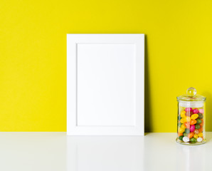 mock up frame on bright yellow paper wall