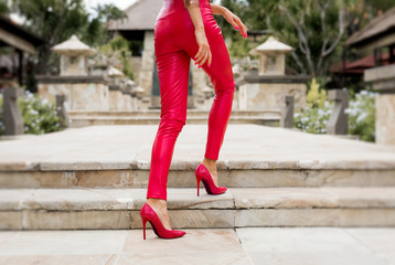 Sexy women legs in red pants and high heels
