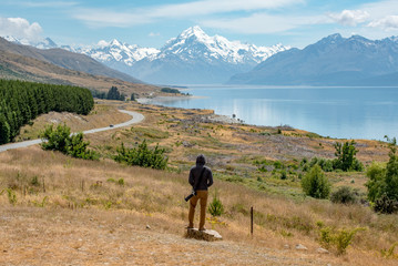 Young male photographer and at Mount Cook, New Zealand