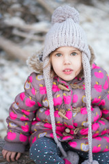 Close up portrait of cute little girl playing in the park