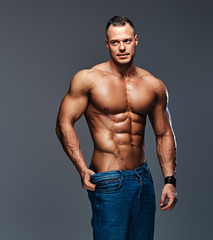 Portrait of shirtless muscular male in a jeans.