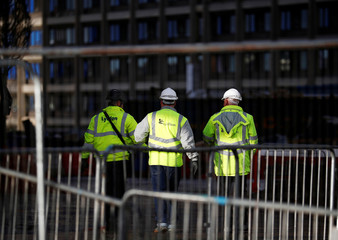 Contractors walk inside Carillion's Royal Liverpool Hospital site in Liverpool