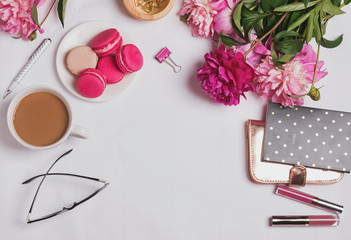 Feminine accessories, coffee with milk and pink peonies on the white background