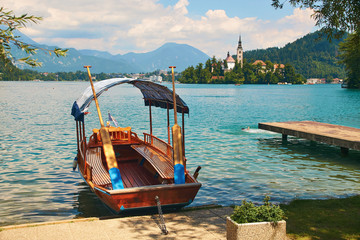 Wooden flat-bottom Pletna boat at the shore of the lake Bled, Slovenia