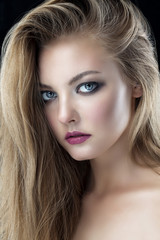 Closeup beauty portrait of young beautiful blond girl with long straight hair with natural makeup. Hairstyle, skincare and cosmetics concept