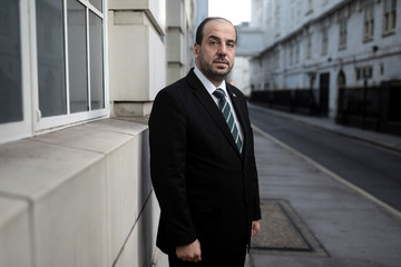 Nasr Hariri, chief negotiator for Syria's main opposition, poses for a photograph in central London