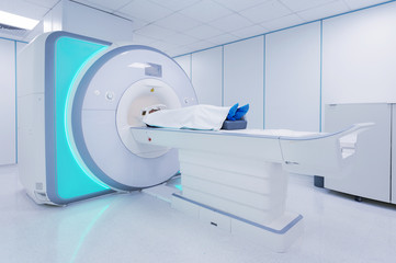 Female pacient undergoing MRI - Magnetic resonance imaging in Hospital. Medical Equipment and Health Care..