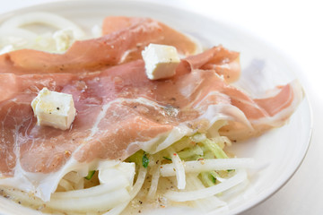 prosciutto ham with cheese and salad in white background