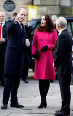 Britain's Prince William and Catherine, the Duchess of Cambridge, are greeted during a visit to Coventry
