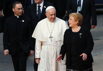 Pope Francis and Chile's president Michelle Bachelet speaks outside the La Moneda presidential palace during his visit in Santiago