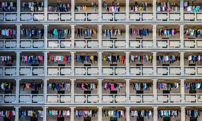 Drying clothes on the balcony of dormitory building