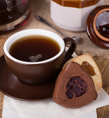 Raspberry Filled Hamantash Cookie and Cup of Coffee