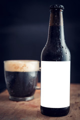 Bottle of dark beer with blank label for your ads