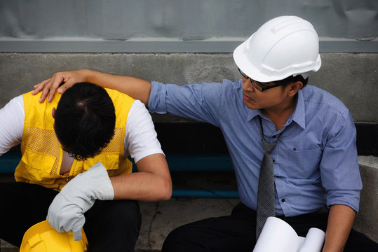 exhausted young foreman at construction site