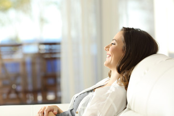 Woman relaxing on vacations in an apartment