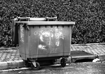 Tagged container. Degradation of public property. Black and white artistic view.