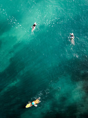Surfing in Bali. Ocean, waves. Taken from the top.