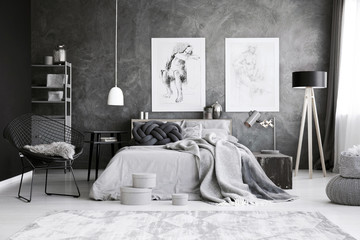 Grey bedroom interior with drawings