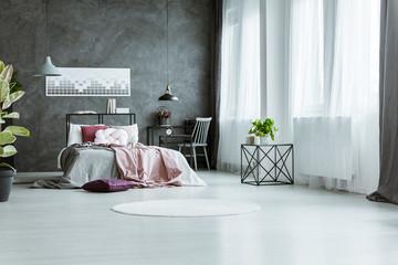 Grey and pink bedroom interior