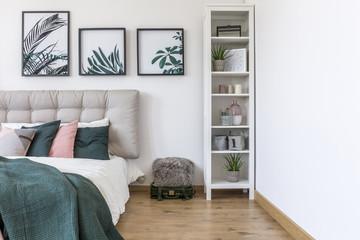 Gallery in green bedroom interior