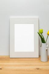 white frame mockup and tulip in vase. Background image for designers
