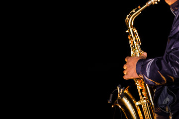saxophonist performing on a dark stage Wall mural