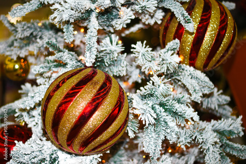 Wallpaper Of A Colorful Christmas Tree Toy On A Tree Branch