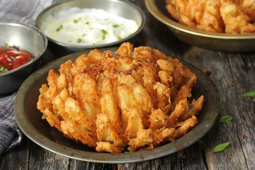 Homemade Blooming Onion with dipping sauce, selective focus