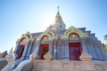 Sinakarintra Stit Mahasantikhiri Pagoda with the sun and lens flare