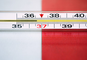 mercury thermometer on a white-red background