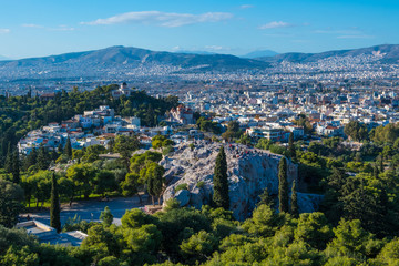 Panoramic view of Athens and Areopagus, a prominent rock outcropping located northwest of the Acropolis in Athens, Greece. In classical times, it functioned as the court for trying deliberate homicide