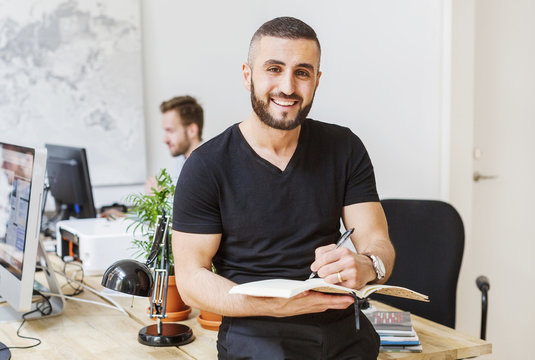 Portrait of young man working at office