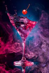 Printed kitchen splashbacks Cocktail cherry falling into a cosmopolitan spashing on smoky background