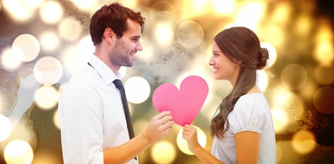 Composite image of pretty brunette giving boyfriend her heart