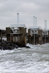 The storm surge barrier Oosterschelde closed for high tide with storm